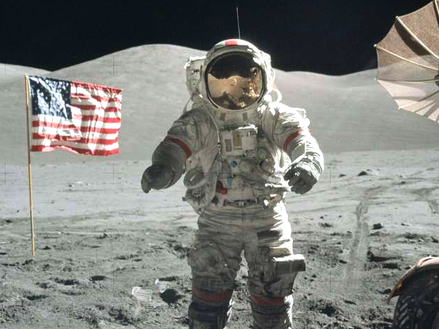 Picture of the first moon landing, with astronaut and American flag