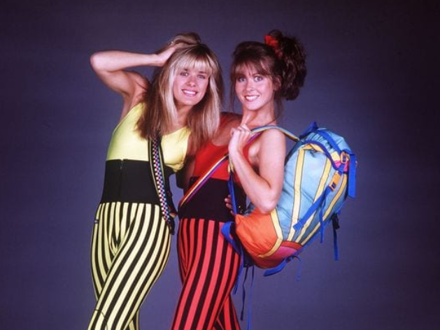 Two women in bright 80s outfits